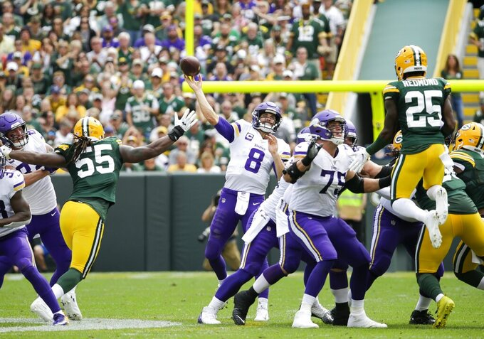 Minnesota Vikings' Kirk Cousins throws during the second half of an NFL football game against the Green Bay Packers Sunday, Sept. 15, 2019, in Green Bay, Wis. (AP Photo/Mike Roemer)