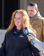FILE - In this Wednesday, Jan. 13, 2021 file photo, Jenny Cudd, front, a flower shop owner and former Midland mayoral candidate, and Eliel Rosa leave the federal courthouse in Midland, Texas. More than 125 people have been arrested so far on charges related to the violent insurrection at the U.S. Capitol, where a Capitol police officer and four others were killed.  (Tim Fischer/Reporter-Telegram via AP)