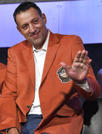 Class of 2019 inductee Vlade Divac waves during a news conference at the Naismith Memorial Basketball Hall of Fame, Thursday, Sept. 5, 2019, in Springfield, Mass. (AP Photo/Jessica Hill)