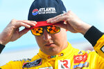 Kyle Busch puts on a cap while in Victory Lane after wining the NASCAR Xfinity Series auto race Saturday, July 10, 2021, in Hampton, Ga. (AP Photo/John Amis)
