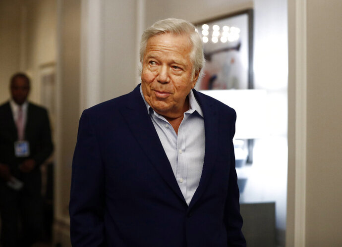 FILE - In this Wednesday, May 22, 2019 file photo, New England Patriots owner Robert Kraft arrives to the NFL football owners meeting in Key Biscayne, Fla. Israel is rolling out the red carpet for New England Patriots owner Robert Kraft, who arrives next week to collect the Genesis Prize, a prestigious award dubbed by its sponsors as the