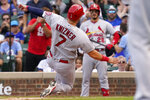 St. Louis Cardinals' Andrew Knizner (7) scores on a wild pitch from Chicago Cubs relief pitcher Codi Heuer during the ninth inning of a baseball game in Chicago, Sunday, Sept. 26, 2021. The St. Louis Cardinals won 4-2. (AP Photo/Nam Y. Huh)