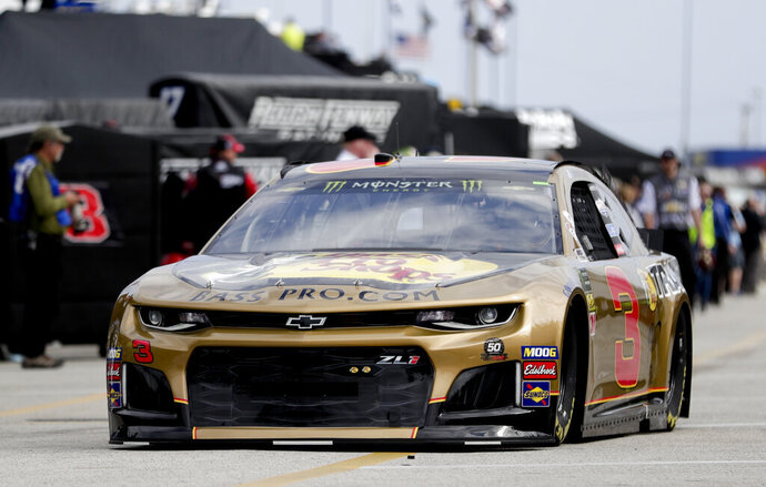 Austin Dillon (3) heads to the track from his garage during NASCAR auto race practice at Daytona International Speedway, Saturday, Feb. 9, 2019, in Daytona Beach, Fla. (AP Photo/John Raoux)