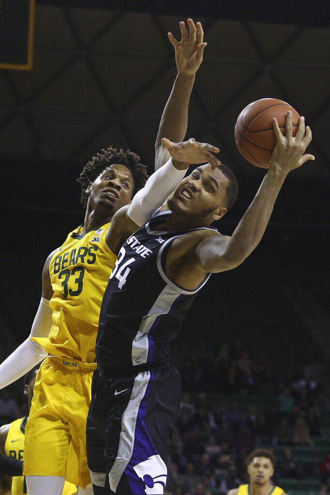 Baylor forward Freddie Gillespie (33) tries to break up the rebound by Kansas State forward Levi Stockard III (34) in the first half of an NCAA college basketball game, Tuesday, Feb. 25, 2020, in Waco, Texas. (AP Photo/ Jerry Larson)