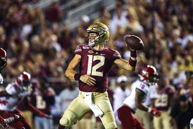 Florida State quarterback Alex Hornibrook (12) throws in the first half of an NCAA college football game against North Carolina State in Tallahassee, Fla., Saturday, Sept. 28, 2019. (AP Photo/Mark Wallheiser)