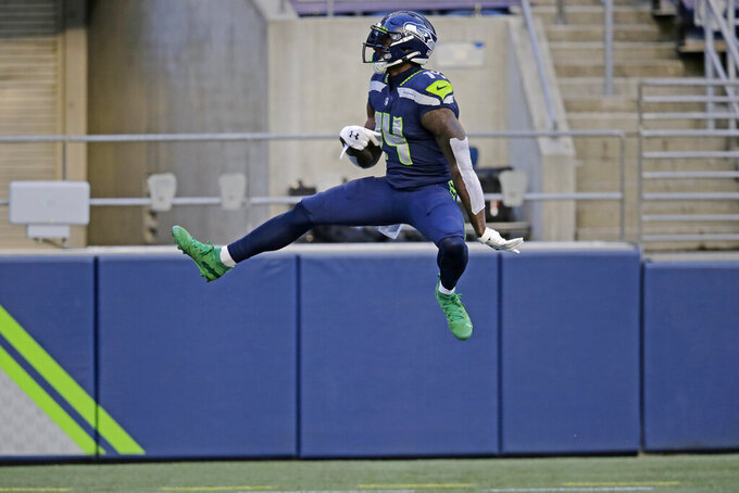 Seattle Seahawks wide receiver DK Metcalf, leaps after scoring a touchdown against the New England Patriots during the first half of an NFL football game, Sunday, Sept. 20, 2020, in Seattle. (AP Photo/John Froschauer)