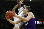 Northwestern forward Miller Kopp (10) attempts a layup as Michigan State forward Gabe Brown defends during the first half of an NCAA college basketball game, Wednesday, Jan. 29, 2020, in East Lansing, Mich. (AP Photo/Carlos Osorio)