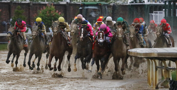 FILE - In this May 4, 2019, file photo, Luis Saez rides Maximum Security, second from right, during the 145th running of the Kentucky Derby horse race at Churchill Downs in Louisville, Ky. Country House was declared the winner after Maximum Security was disqualified following a review by race stewards. (AP Photo/John Minchillo, File)