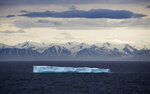FILE - In this July 24, 2017, file photo, an iceberg floats past Bylot Island in the Canadian Arctic Archipelago. In a year of cataclysm, some world leaders at September 2020's annual United Nations meeting are taking the long view, warning: If COVID-19 doesn't kill us, climate change will. With Siberia seeing its warmest temperature on record this year and enormous chunks of ice caps in Greenland and Canada sliding into the sea, countries are acutely aware there's no vaccine for global warming. (AP Photo/David Goldman, File)
