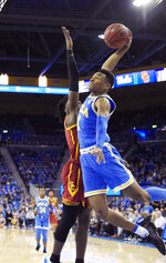 UCLA guard Jaylen Hands, right, goes up for a dunk as Southern California guard Jonah Mathews defends during the first half of an NCAA college basketball game Thursday, Feb. 28, 2019, in Los Angeles. (AP Photo/Mark J. Terrill)