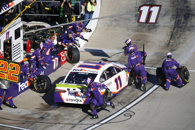 Denny Hamlin (11) gets service in the pits during the NASCAR Cup Series race at Martinsville Speedway in Martinsville, Va., Sunday, Oct. 27, 2019. (AP Photo/Steve Helber)