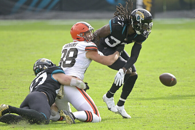 Jacksonville Jaguars cornerback Tre Herndon (37) tries to recover a fumble by Cleveland Browns tight end Harrison Bryant (88) during the first half of an NFL football game, Sunday, Nov. 29, 2020, in Jacksonville, Fla. (AP Photo/Phelan M. Ebenhack)
