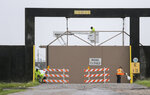 East crews open a gate on the east side of the Inner Harbor Navigational Canal, also known as the Industrial Canal, at Hayne Boulevard in New Orleans, Sunday, July 14, 2019. Tropical Depression Barry dumped rain as it slowly swept inland through Gulf Coast states Sunday, sparing New Orleans from a direct hit but stoking fears elsewhere of flooding, tornadoes, and prolonged power outages. (David Grunfeld/The Advocate via AP)