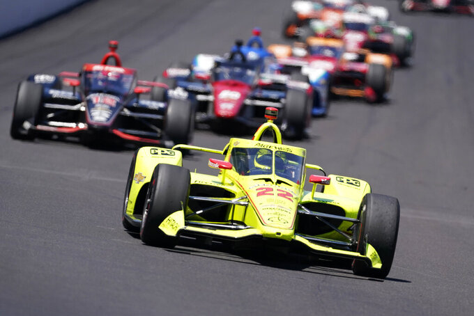 Simon Pagenaud, of France, drives into Turn 1 during the Indianapolis 500 auto race at Indianapolis Motor Speedway, Sunday, May 30, 2021, in Indianapolis. (AP Photo/Darron Cummings)
