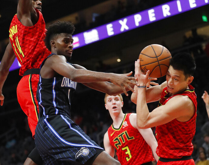 Orlando Magic forward Jonathan Isaac (1) and Atlanta Hawks guard Jeremy Lin (7) fight for a rebound during the second half of an NBA basketball game Sunday, Feb. 10, 2019, in Atlanta. Orlando won 124-108. (AP Photo/John Bazemore)