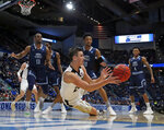 Purdue's Grady Eifert (24) dives to control a rebound against Old Dominion's Aaron Carver (13), Xavier Green (10) and Ahmad Caver (4) during the first half of a first round men's college basketball game in the NCAA Tournament, Thursday, March 21, 2019, in Hartford, Conn. (AP Photo/Elise Amendola)