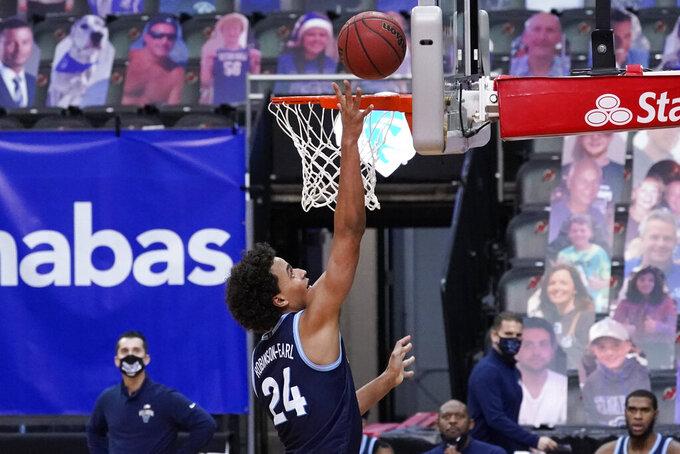 Villanova forward Jeremiah Robinson-Earl scores a goal during the second half of an NCAA college basketball game against Seton Hall, Saturday, Jan. 30, 2021, in Newark, N.J. (AP Photo/Mary Altaffer)