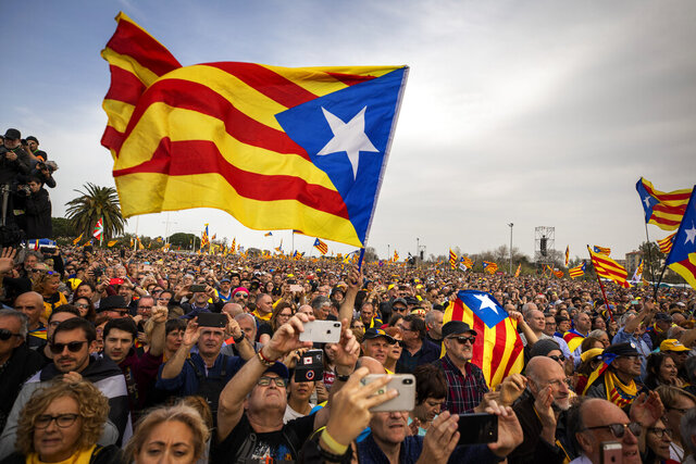 Pro independence demonstrators take part in a political rally in Perpignan,  France, Saturday, 29, 2020. Tens of thousands of people who want the Catalonia region to become independent from Spain on Saturday held a major rally across the border, in southeastern France. (AP Photo/Emilio Morenatti)