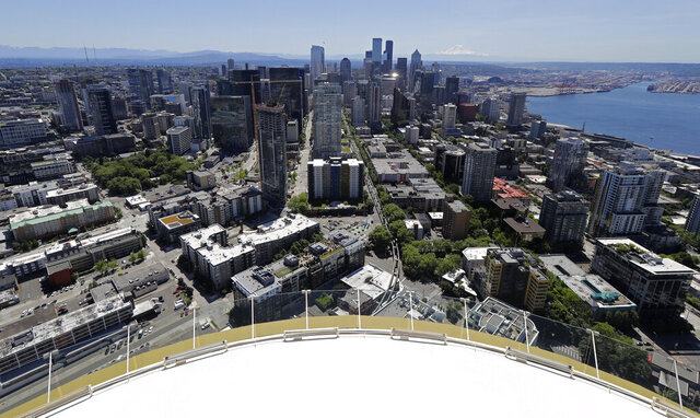 Downtown Seattle and mostly empty streets are shown, Wednesday, May 27, 2020, as viewed from the Space Needle. Many workers continue to work from home due to stay-at-home orders intended to prevent the further spread of the coronavirus. (AP Photo/Ted S. Warren)