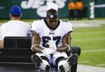 Philadelphia Eagles defensive end Aziz Shittu (67) is carted off the field during the second half of a preseason NFL football game against the New York Jets, Thursday, Aug. 29, 2019, in East Rutherford, N.J. (AP Photo/Matt Rourke)