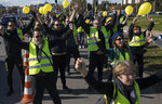 Protesters gather at a traffic intersection during a yellow vest demonstration marking the one year anniversary of the movement in Marseille, southern France, Saturday, Nov. 16, 2019. Police are deployed around key sites in Paris as France's yellow vest protesters prepare to mark the first anniversary of their sometimes-violent movement for economic justice. (AP Photo/Daniel Cole)