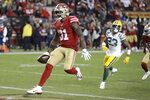 San Francisco 49ers running back Raheem Mostert (31) scores against the Green Bay Packers during the second half of an NFL football game in Santa Clara, Calif., Sunday, Nov. 24, 2019. (AP Photo/Ben Margot)