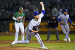 Texas Rangers' Hyeon-Jong Yang pitches against the Oakland Athletics during the fourth inning of a baseball game in Oakland, Calif., Friday, Sept. 10, 2021. (AP Photo/Jeff Chiu)