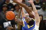 UCLA guard Kris Wilkes, front, is fouled by Colorado forward Alexander Strating while going up to shoot in the second half of an NCAA college basketball game Thursday, March 7, 2019, in Boulder, Colo. Colorado won 93-68. (AP Photo/David Zalubowski)