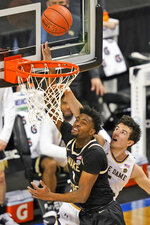 Notre Dame guard Cormac Ryan (5) fouls Wake Forest forward Isaiah Mucius (1) during the second half of an NCAA college basketball game in the first round of the Atlantic Coast Conference tournament in Greensboro, N.C., Tuesday, March 9, 2021. (AP Photo/Gerry Broome)