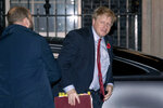 British Prime Minister Boris Johnson arrives back at 10 Downing Street from the Houses of Parliament in London, Tuesday, Oct. 29, 2019. Britons will be heading out to vote in the dark days of December after the House of Commons on Tuesday backed an early national vote that could break the country's political impasse over Brexit — or turn out to be merely a temporary distraction. (AP Photo/Matt Dunham)
