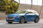 This undated photo provided by Audi shows the 2019 Audi e-tron, a midsize electric SUV with two rows of seating and an estimated range of about 204 miles. (Audi via AP)