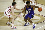 TCU's Mike Miles (1) goes against Oklahoma's Austin Reaves (12) during the second half of an NCAA college basketball game in Norman, Okla., Tuesday, Jan. 12, 2021. (AP Photo/Garett Fisbeck)