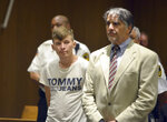 CORRECTS TO SPRINGFIELD NOT HAMPTON DISTRICT COURT - Volodymyr Zhukovskyy, 23, of West Springfield, stands with his attorney Donald Frank during his arraignment in Springfield District Court, Monday, June 24, 2019, in Springfield, Mass. Zhukovskyy, the driver of a truck in a fiery collision on a rural New Hampshire highway that killed seven motorcyclists, was charged Monday with seven counts of negligent homicide.  (Don Treeger/The Republican via AP, Pool)