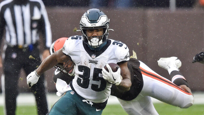 Philadelphia Eagles running back Boston Scott rushes against the Cleveland Browns during the first half of an NFL football game, Sunday, Nov. 22, 2020, in Cleveland. (AP Photo/David Richard)