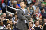 Boston Celtics coach Brad Stevens stands near the bench during the second half of the team's NBA basketball game against the Washington Wizards, Tuesday, April 9, 2019, in Washington. The Celtics won 116-110. (AP Photo/Nick Wass)