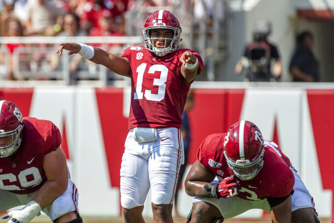 Alabama quarterback Tua Tagovailoa (13) sets a play during the first half of an NCAA college football game against New Mexico State Saturday, Sept. 7, 2019, in Tuscaloosa, Ala. (AP Photo/Vasha Hunt)
