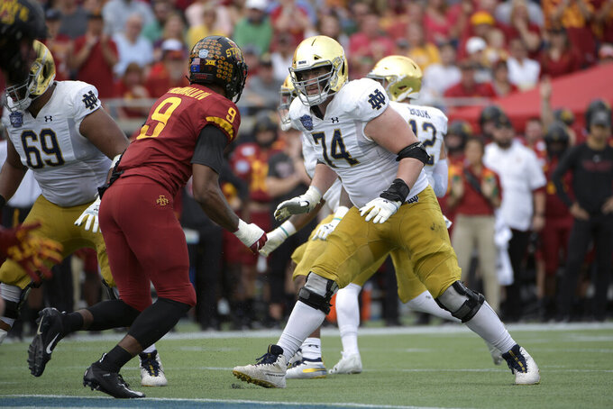 File-Notre Dame offensive lineman Liam Eichenberg (74) sets up to block Iowa State linebacker Will McDonald (9) during the first half of the Camping World Bowl NCAA college football game Saturday, Dec. 28, 2019, in Orlando, Fla. Eichenberg, who heads a veteran offensive front for line coach Jeff Quinn, is projected to be the next Irish lineman to go in the NFL Draft's first round. (AP Photo/Phelan M. Ebenhack, File)