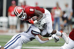 Indiana running back Stevie Scott III (8) is tackled by Connecticut linebacker Omar Fortt (27) during the first half of an NCAA college football game, Saturday, Sept. 21, 2019, in Bloomington, Ind. (AP Photo/Darron Cummings)