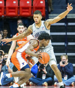 Illinois guard Andres Feliz (10) drives against Penn State' guard Myles Dread (2)during the second half of an NCAA college basketball game in Champaign, Ill., Saturday, Feb. 23, 2019.(AP Photo/Robin Scholz)
