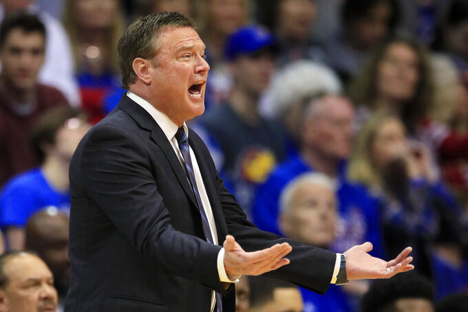 Kansas head coach Bill Self questions a call during the first half of an NCAA college basketball game against Oklahoma in Lawrence, Kan., Saturday, Feb. 15, 2020. (AP Photo/Orlin Wagner)