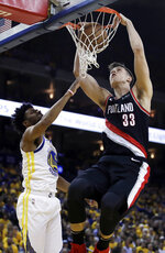 Portland Trail Blazers' Zach Collins, right, scores over Golden State Warriors' Quinn Cook during the second half of Game 1 of the NBA basketball playoffs Western Conference finals Tuesday, May 14, 2019, in Oakland, Calif. (AP Photo/Ben Margot)