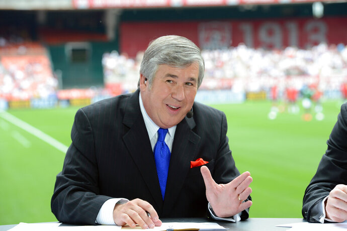 In this June 2, 2013, photo provided by ESPN Images, Bob Ley talks during an international friendly soccer match in Washington, D.C. Ley, an anchor at ESPN since the network's launch 40 years ago, has announced his retirement. Ley was ESPN's longest-tenured anchor, joining