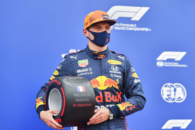 Red Bull driver Max Verstappen of the Netherlands poses after he clocked the fastest time during the qualifying session ahead of the French Formula One Grand Prix at the Paul Ricard racetrack in Le Castellet, southern France, Saturday, June 19, 2021. The French Grand Prix will be held on Sunday. (Nicolas Tucat/Pool via AP)