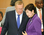 Top IOC member John Coates, left, talks with Tokyo Governor Yuriko Koike, right, before a meeting to assess progress on the Tokyo 2020 Olympics games, in Tokyo Friday, Nov. 1, 2019.  Next year's Olympic marathons and race walks will be run in the northern city of Sapporo as the IOC followed through Friday with a controversial plan to move from Tokyo to the cooler northern city.(Kyodo News via AP)