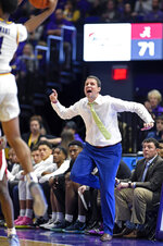 LSU head coach Will Wade gets animated while shouting instructions to his players in the second half of an NCAA college basketball game against Alabama, Wednesday, Jan. 29, 2020, in Baton Rouge, La. LSU won 90-76. (AP Photo/Bill Feig)