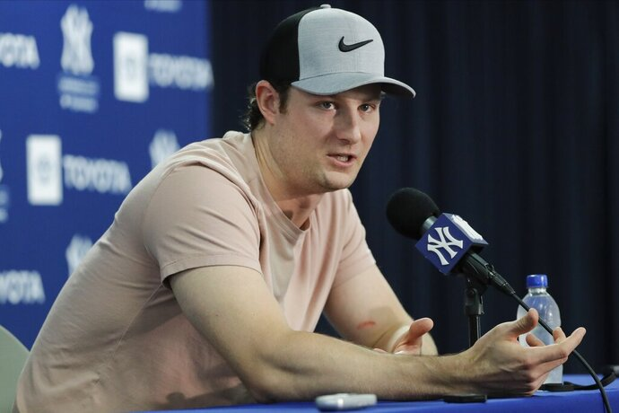 New York Yankees' pitcher Gerrit Cole speaks during a news conference after a spring training baseball workout Thursday, Feb. 13, 2020, in Tampa, Fla. (AP Photo/Frank Franklin II)