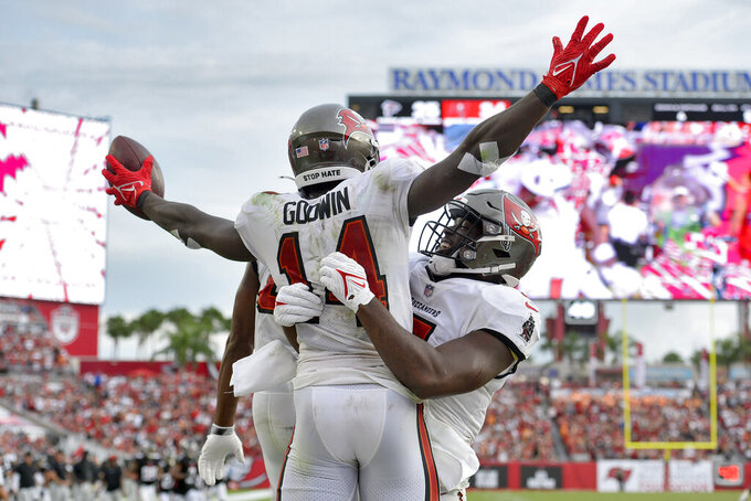 Tampa Bay Buccaneers wide receiver Chris Godwin (14) celebrates with teammates after his touchdown against the Atlanta Falcons during the second half of an NFL football game Sunday, Sept. 19, 2021, in Tampa, Fla. (AP Photo/Jason Behnken)