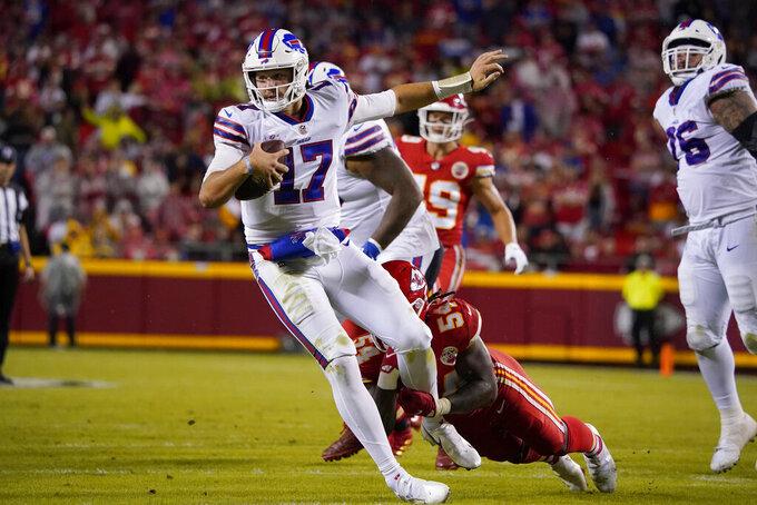 Buffalo Bills quarterback Josh Allen (17) is slowed by Kansas City Chiefs linebacker Nick Bolton (54) during the second half of an NFL football game Sunday, Oct. 10, 2021, in Kansas City, Mo. (AP Photo/Ed Zurga)