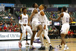 Washington forward Isaiah Stewart, center left, bumps chests with a teammate after drawing a foul from a Houston player during the second half of an NCAA college basketball game Wednesday, Dec. 25, 2019, in Honolulu. Stewart scored on the play. (AP Photo/Marco Garcia)