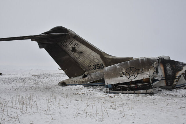 A wreckage of a U.S. military aircraft that crashed in Ghazni province, Afghanistan, is seen Monday, Jan. 27, 2020. The aircraft crashed in Ghazni province on Monday, A U.S. military aircraft crashed in eastern Afghanistan on Monday, an American official said, adding that there were no indications so far it'd been brought down by enemy fire. (AP PhotolSaifullah Maftoon)